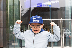 Young Campbell Fleckney, who will turn 7 on the day of the big game poses with his new Spurs cap in front of the club's stadium, ahead of Tottenham's Champions League final with Liverpool to be played at Atletico Madrid's Wanda Metropolitano Stadium in Madrid. Tottenham, London, May 29 2019.