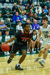 BLOOMINGTON, IL - November 12: Nigel Ferrell cuts in on Doug Wallen during a college basketball game between the IWU Titans  and the Blackburn Beavers on November 12 2019 at Shirk Center in Bloomington, IL. (Photo by Alan Look)