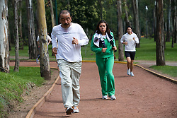 People run in the SOPE, a track and exercise area in the Chapultepec Park in Mexico City.