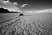 An infrared image showing a rock and the track it slid along in the Racetrack at Death Valley National Park.