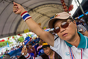 15 FEBRUARY 2014 - BANGKOK, THAILAND: An anti-government protestor applauds an anti-government speaker at the Chaeng Watthana stage of the anti-government Shutdown Bangkok protests. The protests, organized by the  People's Democratic Reform Committee (PDRC), have tried to shutdown the Thai capital but crowds at the venues are getting smaller and police have taken back a couple of protest sites.     PHOTO BY JACK KURTZ