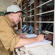 A climber signs the log book at the ranger station at Mweka Gate after finishing an expedition climbing Mt Kilimanjaro.