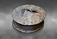 Early Minoan round metal jewel box with a dog in relief on lid,  George of the Dead 2600-2300 BC BC, Heraklion Archaeological  Museum, grey background  . .<br /> <br /> If you prefer to buy from our ALAMY PHOTO LIBRARY  Collection visit : https://www.alamy.com/portfolio/paul-williams-funkystock/minoan-art-artefacts.html . Type -   Heraklion   - into the LOWER SEARCH WITHIN GALLERY box. Refine search by adding background colour, place, museum etc<br /> <br /> Visit our MINOAN ART PHOTO COLLECTIONS for more photos to download  as wall art prints https://funkystock.photoshelter.com/gallery-collection/Ancient-Minoans-Art-Artefacts-Antiquities-Historic-Places-Pictures-Images-of/C0000ricT2SU_M9w