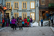 Quebec City, Quebec, Canada -- November 30, 2019.  Shoppers and tourists gather at the Funicular Station in the Old Town section of Quebec City, Canada.