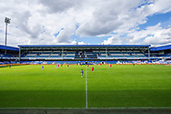A wide view of play and empty stands, no fans, during the EFL Sky Bet Championship match between Queens Park Rangers and Barnsley at the Kiyan Prince Foundation Stadium, London, England on 20 June 2020.