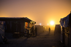 October 23, 2016 - Calais, Calais, France - Calais , France . Dawn at the Calais migrant camp known as '' The Jungle '' , in Northern France , on the final day before the eviction and destruction of the camp  (Credit Image: © Joel Goodman/London News Pictures via ZUMA Wire)