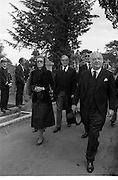 Funeral of Eamon DeValera.   (J72)..1975..02.09.1975..09.02.1975..2nd September 1975..Today saw the funeral of Eamon DeValera. He was laid to rest beside his wife Sinead in Glasnevin Cemetery,Dublin. Dignitries from all around the world attended at the funeral..Picture of Princess Grace of Monaco and Lord Killanin leaving the graveside after the ceremony.