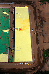 CANADA ALBERTA FORT MCMURRAY 20JUL09 - Aerial view of toxic sulphurous tailings collected in a  pond at the CNRL (Canadian Natural Resources Limited) Sag-D site in the Boreal forest north of Fort McMurray, northern Alberta, Canada...The tar sand deposits lie under 141,000 square kilometres of sparsely populated boreal forest and muskeg and contain about 1.7 trillion barrels of bitumen in-place, comparable in magnitude to the world's total proven reserves of conventional petroleum. Current projections state that production will  grow from 1.2 million barrels per day (190,000 m³/d) in 2008 to 3.3 million barrels per day (520,000 m³/d) in 2020 which would place Canada among the four or five largest oil-producing countries in the world...The industry has brought wealth and an economic boom to the region but also created an environmental disaster downstream from the Athabasca river, polluting the lakes where water and fish are contaminated. The native Indian tribes of the Mikisew, Cree, Dene and other smaller First Nations are seeing their natural habitat destroyed and are largely powerless to stop or slow down the rapid expansion of the oil sands development, Canada's number one economic driver...jre/Photo by Jiri Rezac / GREENPEACE..© Jiri Rezac 2009
