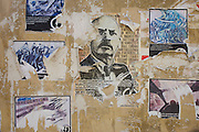 Political posters peeling on a wall in the northern Italian city of Trento.