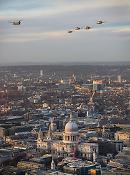 © Licensed to London News Pictures. 16/01/2018. London, UK.  The last four remaining British Army Lynx helicopters are escorted by a Chinook as they fly in formation over St Paul's Cathedral in central London. The British made aircraft is being decommissioned after almost 40 years in service. Photo credit: Peter Macdiarmid/LNP