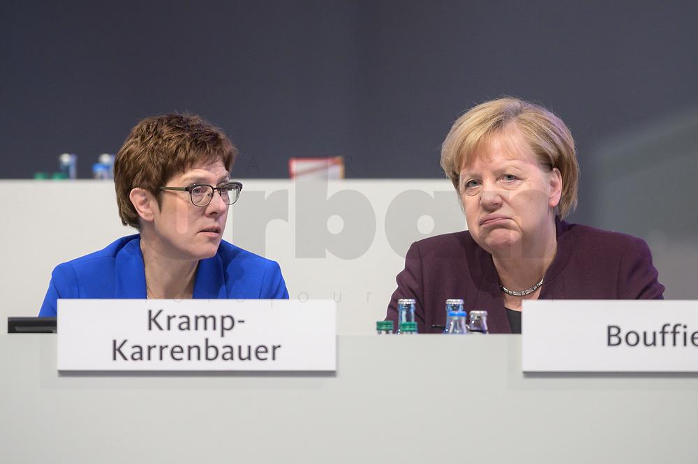 22 NOV 2019, LEIPZIG/GERMANY:<br /> Annegret Kramp-Karrenbauer (L), CDU Bundesvorsitzende und Bundesverteidigungsministerin, und Angela Merkel (R), CDU, Bundeskanzlerin, im Gespraech, CDU Bundesparteitag, CCL Leipzig<br /> IMAGE: 20191122-01-247<br /> KEYWORDS: Parteitag, party congress, Gespräch