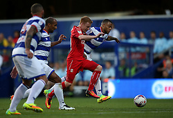 Swindon Town's James Brophy and Queens Park Rangers's Jordan Cousins battle for the ball