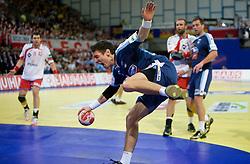 Jure Dobelsek of Slovenia injured during the Men's Handball European Championship Group C match between Slovenia and Poland at the Olympia Hall on January 22, 2009 in Innsbruck, Austria. Slovenia vs. Poland: 30:30. (Photo by Vid Ponikvar / Sportida) - on January 2010