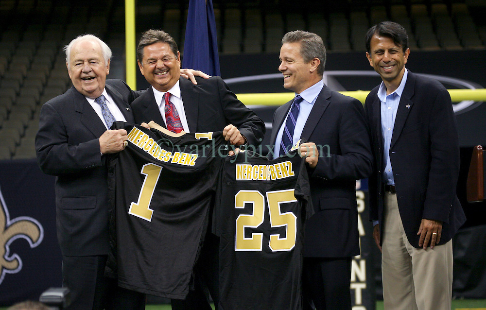 04 October 2011. New Orleans, Louisiana, USA.  <br /> NFL's New Orleans Saints announce a multi million dollar deal with Mercedes-Benz for naming rights on the Louisiana Superdome. Now the Mercedes-Benz Superdome. L/R Saints owner Tom Benson, Mercedes-Benz USA President and CEO Ernst Leib, Mercedes-Benz VP Marketing Stephen Cannon and Louisiana Governor Bobby Jindal.<br /> Photos; Charlie Varley/varleypix.com