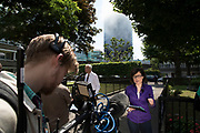 TV and other media here Jane Hill of the BBC reporting from near to a blaze at Grenfell Tower near Notting Hill on 14th June 2017 in West London, United Kingdom. The huge fire engulfed the tower block, trapping many people in their homes. A number of fatalities are reported. The block of flats in the Borough of Kensington and Chelsea, billowed large plumes of smoke way above the capital after the blaze broke out in the early hours of Wednesday morning. Londoners came out on the streets to help, offer food and water, support and assistance to those who had lost their homes or didn't know the whereabouts of their friends and family.