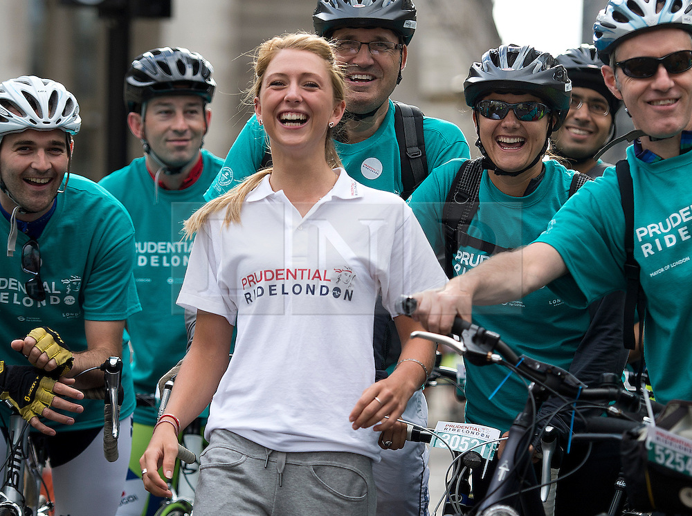 © London News Pictures. 03/08/2013. London, UK. Double Olympic gold medalist Laura Trott talking to cyclists at the start line of a world record attempt before the Prudential Ride London event. Cycling enthusiasts of all ages take part in the Prudential RideLondon cycling event through central London. RideLondon is an annual two-day festival of cycling, part of the legacy of the 2012 Games. Photo credit: Ben Cawthra/LNP