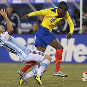 Javier Mascherano, (left), Argentina, is challenged by Enner Valencia, Ecuador, during the Argentina Vs Ecuador International friendly football match at MetLife Stadium, New Jersey. USA. 15th November 2013. Photo Tim Clayton