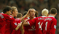 Photo: Aidan Ellis.<br /> Manchester Utd v Tottenham Hotspur. The Barclays Premiership. 22/10/2005.<br /> United's mikkael silvestre is congratulated on his goal by Darren Fletcher and Ruud Van Nistelrooy