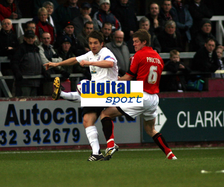 Photo: Mark Stephenson/Sportsbeat Images.<br /> Hereford United v Accrington Stanley. Coca Cola League 2. 24/11/2007.Hereford's Ben Smith cleares the ball from Andrew Procter