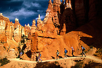 Hikers traverse a trail in Bryce Canyon National Park, Utah