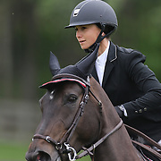 Georgina Bloomberg riding Calista in action during the $35,000 Grand Prix of North Salem presented by Karina Brez Jewelry during the Old Salem Farm Spring Horse Show, North Salem, New York, USA. 15th May 2015. Photo Tim Clayton