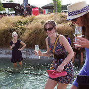Wine lovers at the Marlborough Wine Festival, Brancott Estate Winery, Marlborough, South Island, New Zealand..Over 8000 wine and food lovers attend New Zealand's most popular and successful wine festival showcasing the regions best wines produced by around 110 wineries. Festival goers get the opportunity to sample a unique selection of wines and local foods at Marlborough's Brancott Estate winery. For the wine aficionados there are two wine tutorials from the region's leading winemakers and viticulturist. The festival includes a fashion in the vines competition  and live music throughout the day...The Marlborough wine region is New Zealand's largest wine producer and has earned a global reputation for viticultural excellence since the 1970s. It has an enviable international reputation for producing the best Sauvignon Blanc in the world. It also makes very good Chardonnay and Riesling and is fast developing a reputation for high quality Pinot Noir. Of the region's ten thousand hectares of grapes (almost half the national crop) one third are planted in Sauvignon Blanc. . Marlborough, New Zealand, 12th February 2011. Photo Tim Clayton.