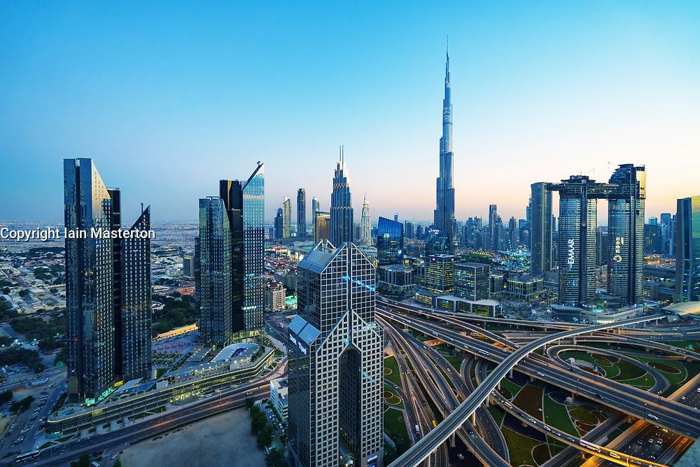 Skyline of Dubai, Sheikh Zayed Road and Burj Khalifa skyscraper at dusk in Dubai, United Arab Emirates