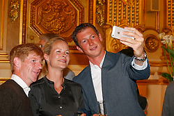 Selfie time with Markus Ehning (GER), Malin Baryard (SWE), Daniel Deusser (GER)<br /> Draw for the first competition at the city hall of Lyon<br /> FEI Longines World Cup Final - Lyon 2014<br /> © Dirk Caremans