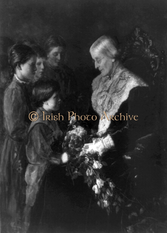 Susan B. Anthony 1903. Holding flowers, with four children. Unknown