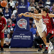 UNCASVILLE, CONNECTICUT- DECEMBER 19:  Gabby Williams #15 of the Connecticut Huskies challenged by Maddie Manning #23 of the Oklahoma Sooners during the Naismith Basketball Hall of Fame Holiday Showcase game between the UConn Huskies Vs Oklahoma Sooners, NCAA Women's Basketball game at the Mohegan Sun Arena, Uncasville, Connecticut. December 19, 2017 (Photo by Tim Clayton/Corbis via Getty Images)