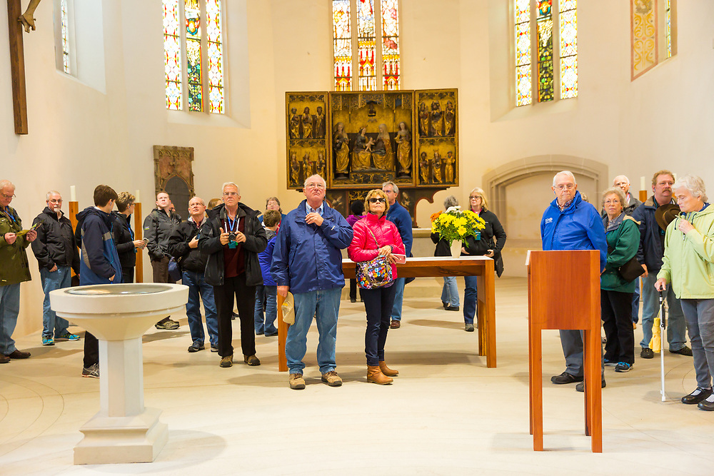 Tour members visit the Church of St. Peter and St. Paul in Eisleben, Germany Friday, October 27th. Martin Luther was baptized in the church. At left is the reconstructed baptismal font that was used for Martin Luther.