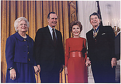 File photo : United States President George H.W. Bush presents the Medal of Freedom award to former U.S. President Ronald Reagan at a ceremony in the East Room of the White House on January 13, 1993. Left to right: First Lady Barbara Bush; U.S. President George H.W. Bush; former First Lady Nancy Reagan; former U.S. President Ronald Reagan.<br /> Credit: White House via CNP/ABACAPRESS.COM