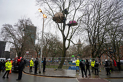© Licensed to London News Pictures. 27/01/2021. London, UK. Police officers evict a group of HS2 Rebellion protesters in Euston Square Gardens. It is reported the protesters have built a 100ft tunnel under the gardens and are protesting against the HS2 train line development. Photo credit: Ray Tang/LNP