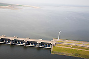 Nederland, Zuid-Holland, Goeree-Overflakkee, 04-07-2006; dam and sluices between islands Goeree-Overflakkee en Voorne-Putten; the sluices are for sluicing water coming from the rivers from naturabassin (lower part of the photo) to the North sea.Haringvlietsluizen en begin Haringvlietdam, gezien in de richting van Noordzee; de sluizen zijn spui-sluizen en zorgen er voor dat het zoete water uit het Haringvliet (links op de foto) zoals aangevoerd door Maas en Rijn geloosd kan worden, op de foto de schuiven van de sluizen in gesloten toestand.l.luchtfoto (toeslag),  aerial photo (additional fee required); .foto Siebe Swart