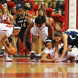 Rutgers Scarlet Knights guard Briyona Canty (25) recovers a ball mishandled by Notre Dame Fighting Irish forward Natalie Achonwa (11) and tipped away by Rutgers Scarlet Knights guard/forward Betnijah Laney (44) during second half NCAA Big East women's basketball action between Notre Dame and Rutgers at the Louis Brown Athletic Center. Notre Dame defeated Rutgers 71-41.