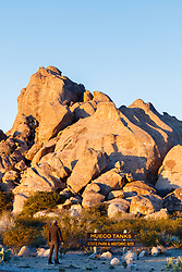 Sunset on rocks and entrance sign, Hueco Tanks State Park & Historic Site, El Paso, Texas. USA.