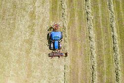 THEMENBILD - zusammen fassen des Heu zu einer Schwade mit einem Traktor und Heuschwader. Aufgenommen am Mittwoch 24. Juni 2020 in Kals am Grossglockner, Oesterreich // Gather the hay into a swath with a tractor and hay rake. Kals, Austria on Wednesday, June 24, 2020. EXPA Pictures © 2020, PhotoCredit: EXPA/ Johann Groder