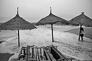 Lone vietnamese woman along a beach of Nha Trang, Vietnam, Southeast Asia