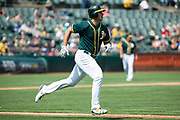 Oakland Athletics first baseman Matt Olson (28) hits a single against the Los Angeles Angels at Oakland Coliseum in Oakland, California, on September 6, 2017. (Stan Olszewski/Special to S.F. Examiner)