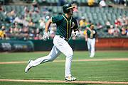 Oakland Athletics first baseman Matt Olson (28) hits a single against the Los Angeles Angels at Oakland Coliseum in Oakland, California, on September 6, 2017. (Stan Olszewski/Special to S.F. Examiner)