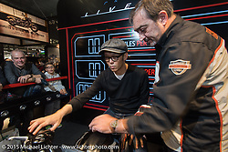 """""""Tad"""" Tadashi Kono of Japan tries out the Harley-Davidson Live Wire electric bike at EICMA, the largest international motorcycle exhibition in the world. Milan, Italy. November 20, 2015.  Photography ©2015 Michael Lichter."""