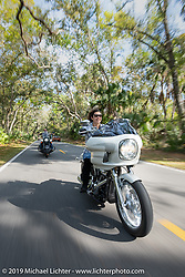 Vanessa Klock riding her 2018 Harley-Davidson Softail Lowrider with a FXRP style fairing and lots of Klock Werks details on a ride through Tomoka State Park during Daytona Beach Bike Week, FL. USA. Friday, March 15, 2019. Photography ©2019 Michael Lichter.