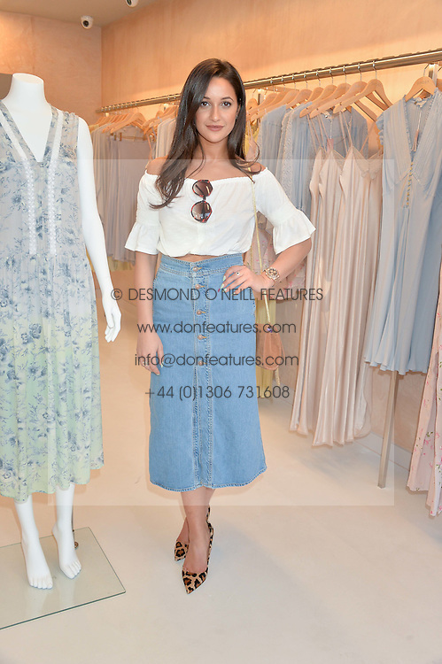 ROXIE NAFOUSI at a party to celebrate the re-launch of the Ghost Flagship store at 120 King's Road, London on 15th April 2015.