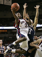 Gonzaga's Jeremy Pargo drives to the basket past Nevada's Ramon Sessions during the first half of a basketball game in Seattle. (AP Photo/John Froschauer).