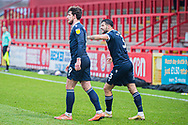 GOAL 1-2 Morecambe forward Cole Stockton (9) scores and celebrates with Morecambe defender Stephen Hendrie (3)  during the EFL Sky Bet League 2 match between Stevenage and Morecambe at the Lamex Stadium, Stevenage, England on 6 February 2021.