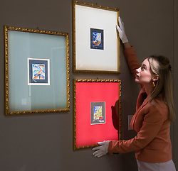 Bonhams, London, February 27th 2017. A Bonhams staff member straightens a set of three watercolours by Mino Della Site; 'Sintesi di Virata', 'Aeropittura' and 'Sogno Delli'Aviere', with the set expected to fetch between £5,000 and £7,000, at the Bonhams impressionist and modern art sale press preview at their Mayfair gallery in London.