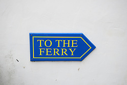 Ferry sign, Marazion, Cornwall.  When the tide is in the causeway is flooded and tourists have to get a small boat to St Michael's Mount. UK
