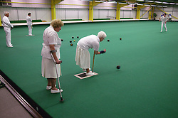 Women with disabilities taking part in a bowls event held at Solihull Indoor Bowls Centre,
