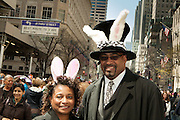 A couple with rabbit-eared hats.