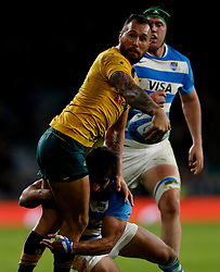 Australia's Quade Cooper and Argentina's Matias Orlando during the Rugby Championship match at Twickenham Stadium, London.